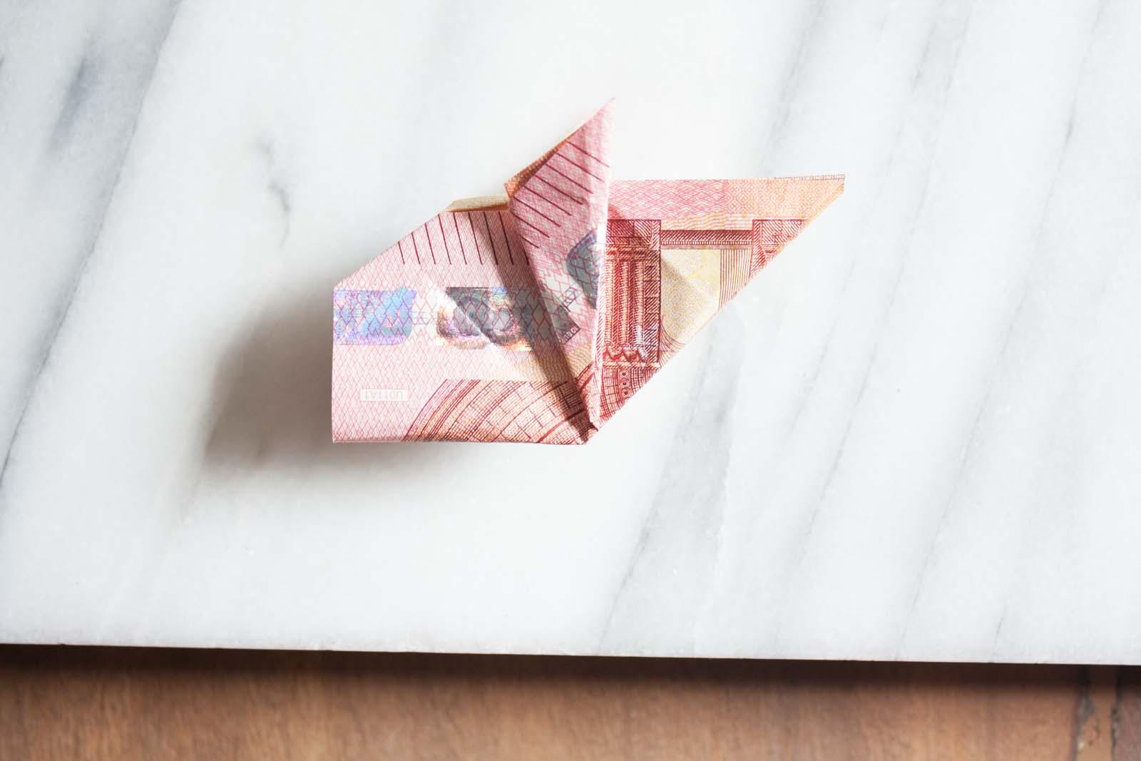 Geldscheine falten: Schweinchen ist erkennbar